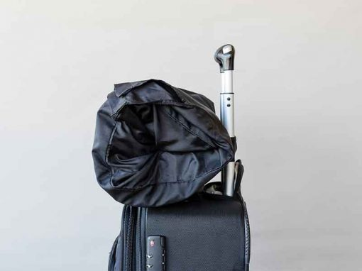 Side view of SleepKeeper on hand luggage suitcase