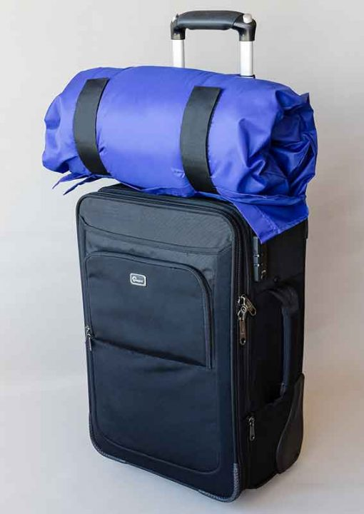 SleepKeeper sitting on hand luggage suitcase