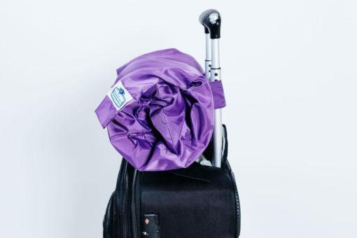 Pillow carry bag compacts a pillow
