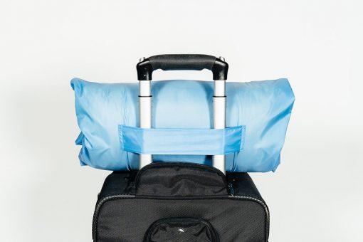 Travel pillow bag slips onto luggage